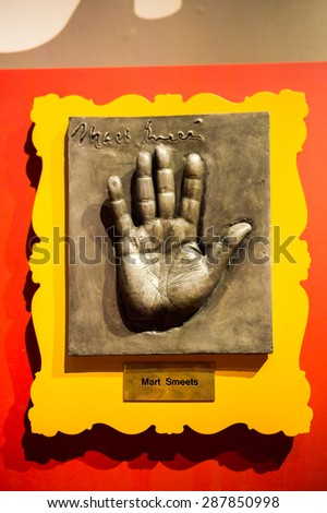 AMSTERDAM, NETHERLANDS - JUN 1, 2015: Mart Smeets hand, Madame Tussauds museum in Amsterdam. Marie Tussaud was born as Marie Grosholtz in 1761 - stock photo