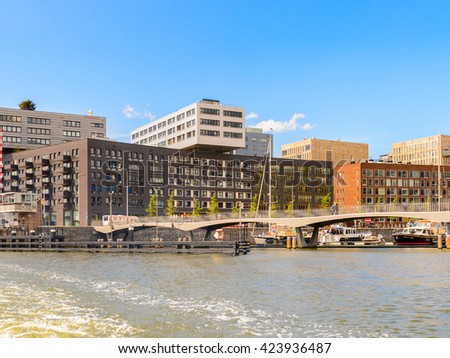 AMSTERDAM, NETHERLANDS - JUN 1, 2015: Modern acrchitecture of Amsterdam. Amsterdam is the capital city and most populous city of the Kingdom of the Netherlands