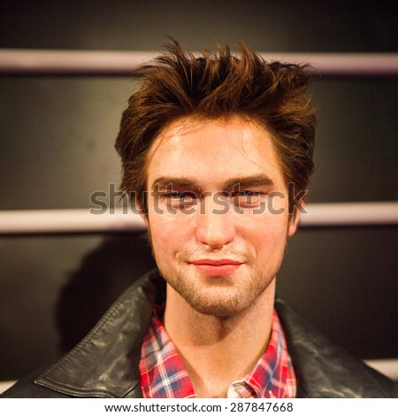 AMSTERDAM, NETHERLANDS - JUN 1, 2015: Robert Pattinson, the actor, Madame Tussauds museum in Amsterdam. Marie Tussaud was born as Marie Grosholtz in 1761 - stock photo