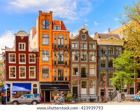 AMSTERDAM, NETHERLANDS - JUN 1, 2015: Typical colorful houses on the Canal of Amsterdam. Amsterdam is the capital city and most populous city of the Kingdom of the Netherlands