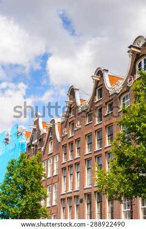 AMSTERDAM, NETHERLANDS - JUN 1, 2015: Typical houses on the Canal of Amsterdam. Amsterdam is the capital city and most populous city of the Kingdom of the Netherlands