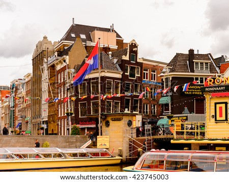 AMSTERDAM, NETHERLANDS - JUNE 1, 2015: Architecture of centre of Amsterdam, Netherlands. Amsterdam is the capital of Netherlands and a popular touristic destination