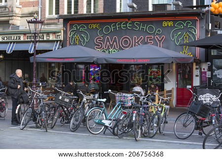Amsterdam, Netherlands - June 29: Bicycles in the city of Amsterdam, Netherlands on June 29, 2014. The locals use the bicycle as a preferred method of transportation.