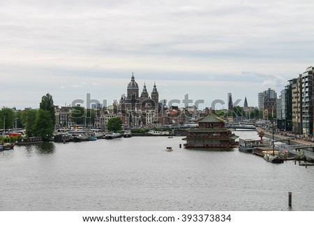 Amsterdam, Netherlands - June 20, 2015: City view from the lookout on the roof of museum Nemo in Amsterdam - stock photo