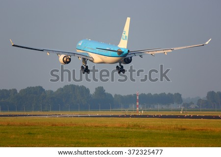 AMSTERDAM, NETHERLANDS - JUNE 5, 2014: KLM Airbus A330-200 PH-AOI landing at Schiphol airport.