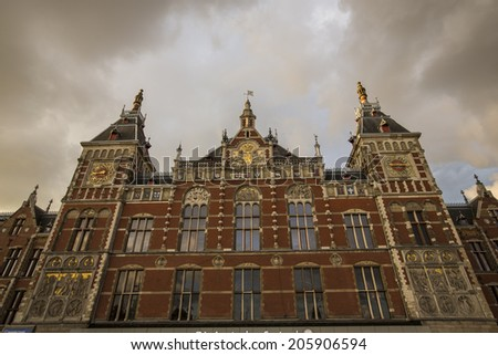 Amsterdam, Netherlands - June 30: People in front of the Central Station building in Amsterdam, Netherlands, on June 30, 2014.