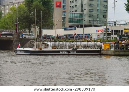 Amsterdam, Netherlands - June 20, 2015: People on the dock landing on river cruise ships, Amsterdam, Netherlands - stock photo
