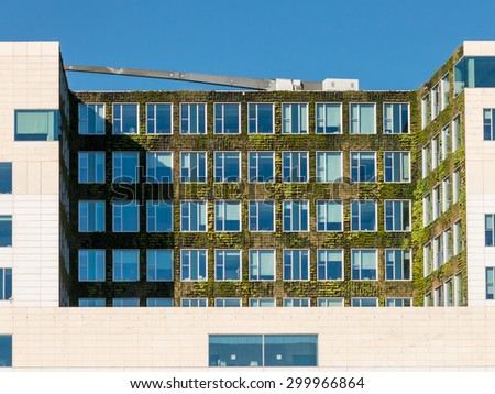 AMSTERDAM, NETHERLANDS - JUNE 6, 2015: Vertical garden on modern building of courthouse in Amsterdam City, Netherlands