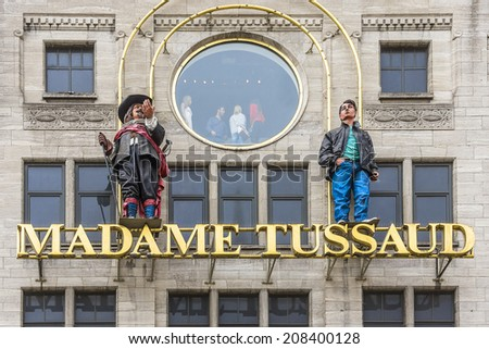AMSTERDAM, NETHERLANDS - JUNE 17, 2014: View of Madame Tussaud wax museum, next to Royal Palace. It is a major tourist attraction in Amsterdam, displaying waxworks of famous figures. - stock photo