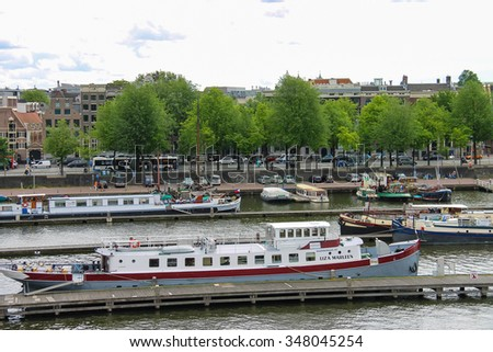 Amsterdam, Netherlands - June 20, 2015: View of the port from the observation deck on the roof of museum Nemo in Amsterdam - stock photo