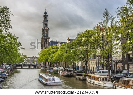 AMSTERDAM, NETHERLANDS - JUNE 15, 2013: Westerkerk (Western church) next to Jordaan district, on the bank of the Prinsengracht canal in Amsterdam, Netherlands. - stock photo