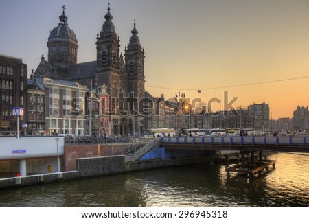 AMSTERDAM, NETHERLANDS - MARCH 18: Basilica of Saint Nicholas on March 18, 2015 in Amsterdam, Netherlands. Amsterdam is the capital and largest city in the Netherlands with a population of 780,000. - stock photo