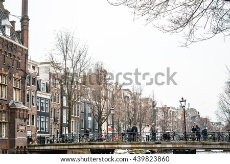 Amsterdam, Netherlands.-March 31, 2016 : Beautiful street view of Traditional old buildings in Amsterdam, the Netherlands  - stock photo