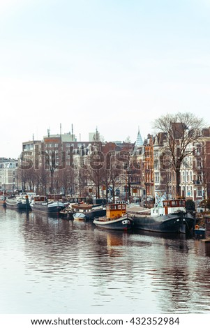 Amsterdam, Netherlands.-March 16, 2016 : Beautiful view of Amsterdam canals with bridge and typical dutch houses. Amsterdam, Netherlands - stock photo
