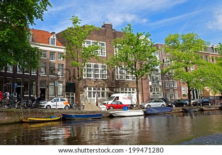 AMSTERDAM, NETHERLANDS - MAY 30: Amsterdam canals on May 30, 2014 in Amsterdam, Netherlands. View of Amsterdam canals and typical dutch houses.