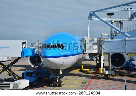 Amsterdam, Netherlands - May 16, 2015: KLM Royal Dutch Airlines airplanes on May 16, 2015 in Amsterdam. KLM is the largest airline of the Netherlands with its hub at Amsterdam airport.  - stock photo