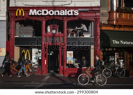 AMSTERDAM, NETHERLANDS - MAY 13, 2015: McDonald's in  retro building in Amsterdam, Holland - stock photo