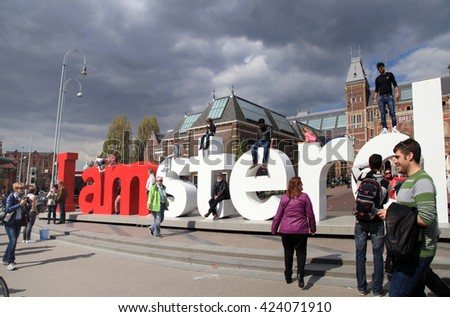 AMSTERDAM, NETHERLANDS - MAY 4, 2016: People in front of the Rijksmuseum and popular statue 'I Amsterdam', Amsterdam, Netherlands. - stock photo