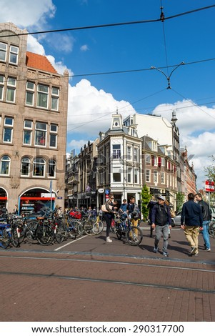 Amsterdam, Netherlands May 28, 2015: street with the house in Amsterdam on a sunny day. Amsterdam - capital and largest city of the Netherlands. It is the capital of the kingdom since 1814. - stock photo