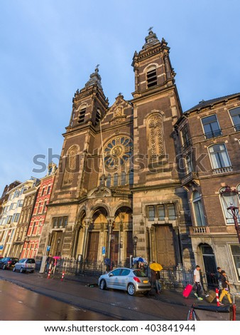 AMSTERDAM, NETHERLANDS - MAY 29, 2015: The Basilica of Saint Nicholas is located in the Old Centre district of Amsterdam, Netherlands. It is the city's major Catholic church. - stock photo