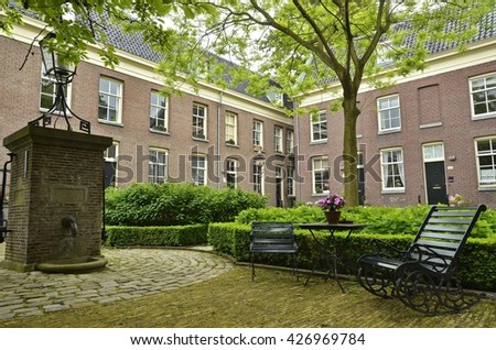 Amsterdam, Netherlands - May 21, 2016: The East side of the hidden garden on the Prinsengracht canal, near the Noorder Markt