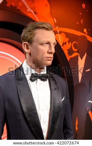 AMSTERDAM, NETHERLANDS - May 5, 2016:  the wax figur of Daniel Craig as the agent 007 James Bond   in Madame Tussauds museum in Amsterdam.  - stock photo