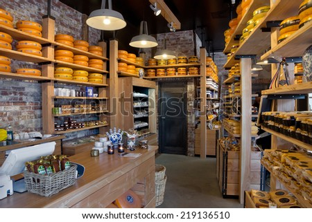 AMSTERDAM, NETHERLANDS - MAY 30: Whole Dutch cheeses fill the shelves of a specialist cheese shop on May 30, 2014 in Amsterdam, Netherlands. Danish cheese is very popular in the Netherlands.  - stock photo