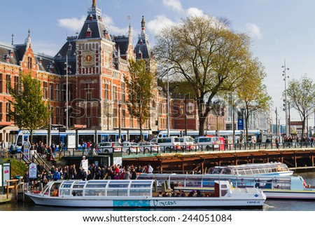 AMSTERDAM, NETHERLANDS - NOVEMBER 08: Amsterdam Central Station, Netherlands on November 08, 2014. Tourist boars are a popular way to move around Amsterdam. - stock photo