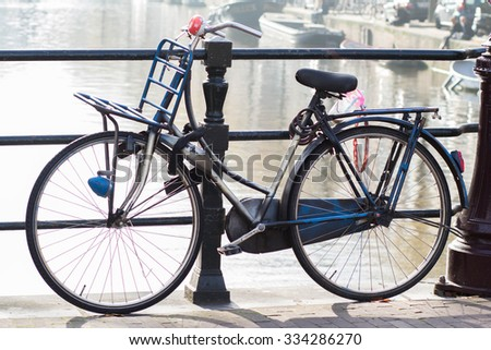 Amsterdam,Netherlands - October 30, 2015:  Bicycle  parking near by the canal in Amsterdam