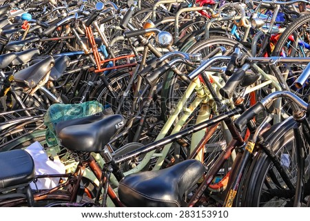 AMSTERDAM, NETHERLANDS,OCTOBER,09 : Bicycle street parking. Amsterdam - the bicycle capital of Europe and one of the most original and unique cities of Europe on October 09,2014   - stock photo