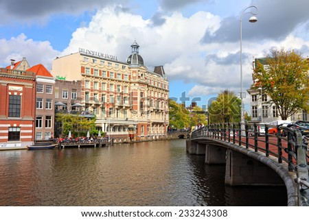 AMSTERDAM, NETHERLANDS, OCTOBER,10: Canal  dock cafe and NH Doelen Hotel view. Netherlands, on October 10, 2014  - stock photo