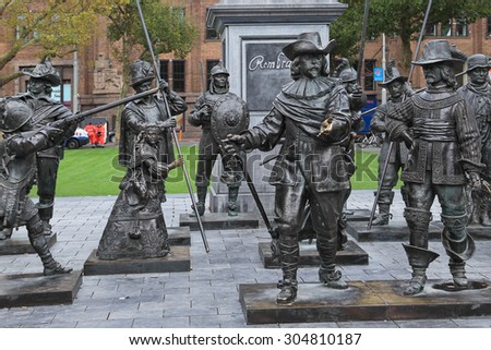 "AMSTERDAM,NETHERLANDS - OCTOBER 10,2014 : Monument to famous painter Rembrandt and sculptures of his picture ""Night watch'' on Rembrandtplein (Rembrandt Square) is a major square in central Amsterdam"