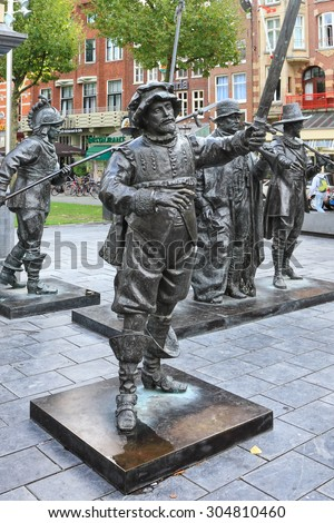 "AMSTERDAM,NETHERLANDS - OCTOBER 10,2014 : Monument to famous painter Rembrandt and sculptures of his picture ""Night watch'' on Rembrandtplein (Rembrandt Square) is a major square in central Amsterdam  - stock photo"