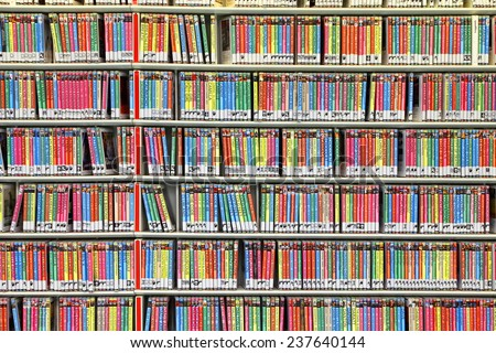 AMSTERDAM, NETHERLANDS - OCTOBER 09: Shelves with video disks in Central Public Library of Amsterdam on October 09, 2014. This  library is the biggest in Netherlands  - stock photo