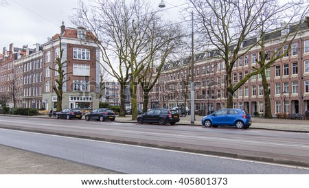 AMSTERDAM, NETHERLANDS on APRIL 1, 2016. Typical urban view in the spring morning.