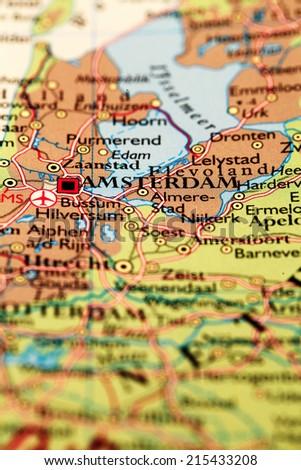 Amsterdam, Netherlands on atlas world map - stock photo