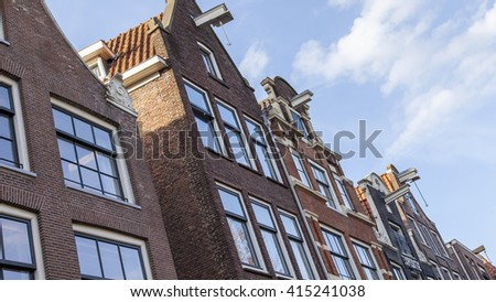 AMSTERDAM, NETHERLANDS on MARCH 28, 2016. Typical architectural details of houses XVII-XVIII of construction.