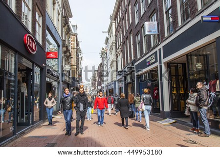 AMSTERDAM, NETHERLANDS on MARCH 31, 2016. Typical urban view. Pedestrians go down the street