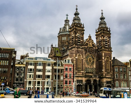 AMSTERDAM, NETHERLANDS - SEP 2: Basilica of St. Nicholas in Amsterdam, Netherlands on September 2, 2013. Amsterdam is the capital city and most populous city of the Kingdom of the Netherlands. - stock photo