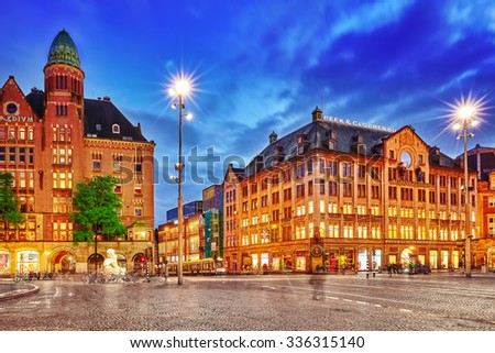 AMSTERDAM, NETHERLANDS - SEPTEMBER 15, 2015: Beautiful Amsterdam, centre of  Dam Square in the evening. Square is a central place for local inhabitants and tourists of the Dutch capital. Netherlands - stock photo