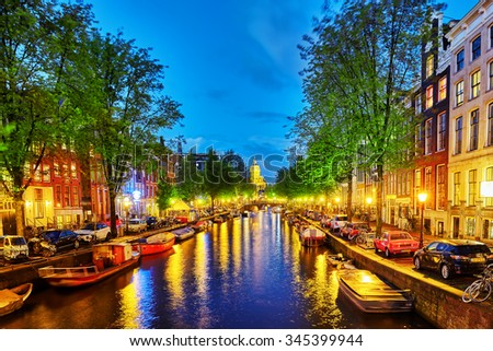 AMSTERDAM, NETHERLANDS-SEPTEMBER 15, 2015:Beautiful Amsterdam city, canals at the evening time. Netherlands - stock photo