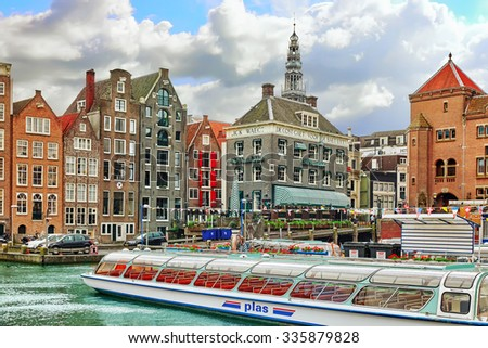 """AMSTERDAM, NETHERLANDS - SEPTEMBER 15, 2015: Beautiful views of the streets, ancient buildings, people, embankments of Amsterdam - also call """"Venice in the North"""". Netherland - stock photo"""