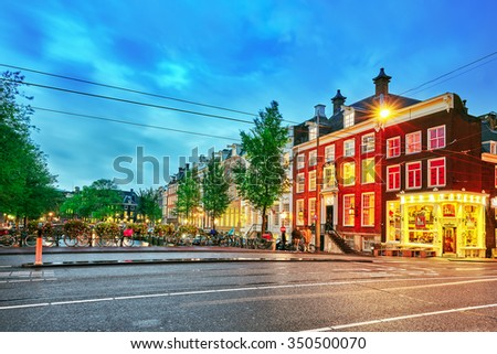"AMSTERDAM, NETHERLANDS - SEPTEMBER 15, 2015: Beautiful views of the streets, ancient buildings, people, embankments of Amsterdam - also call ""Venice in the North"". Netherland"