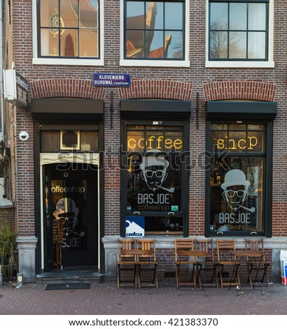 AMSTERDAM, NETHERLANDS - 17TH FEBRUARY 2016: The outside of a Coffee Shop in Amsterdam during the day - stock photo