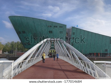 AMSTERDAM - October 16, 2013: The Nemo Museum, the largest science childrens museum, center of tourism in the Netherlands in Amsterdam. It is the country's fourth most visited museum. - stock photo