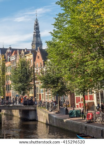 AMSTERDAM - OCTOBER 3: The Old church with Amsterdam city scene with bicycles along canal in Netherlands, on October 3, 2015.