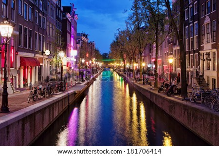Amsterdam Red Light District by night in the old part of the city, North Holland, the Netherlands. - stock photo