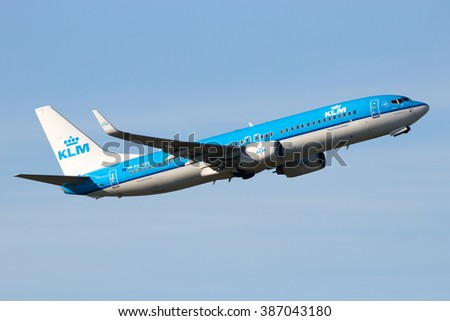 AMSTERDAM-SCHIPHOL - FEB 16, 2016: KLM Royal Dutch Airlines Boeing 737 take-off from Schiphol airport - stock photo