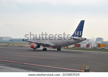 AMSTERDAM/SCHIPHOL, THE NETHERLANDS, 26 March 2015 - Airplane from Scandinavian Airlines SAS departing on Amsterdam Airport Schiphol. - stock photo