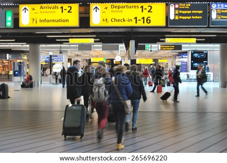 AMSTERDAM/SCHIPHOL, THE NETHERLANDS, 26 MARCH 2015 - Airplane passengers hurrying to get their plane on Amsterdam Airport Schiphol. - stock photo